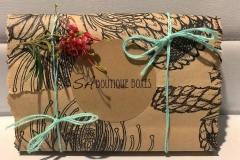 Raw Botanical Wrap with Light Blue Twine and Native Flower